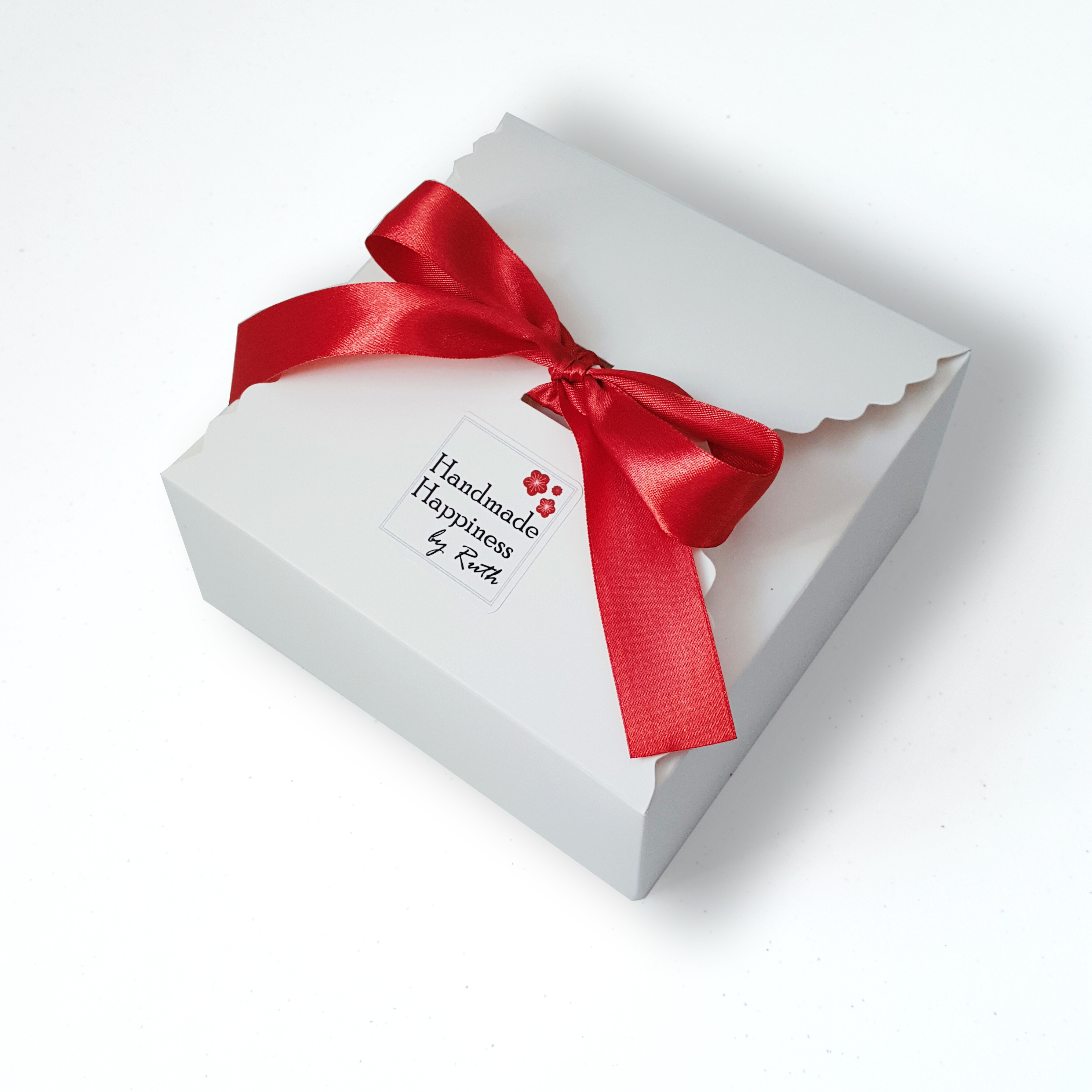 Travel toys come in a white box with red ribbon