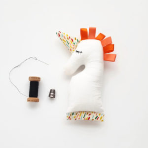 Orange baby unicorn rattle